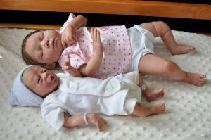 preemie and full term babies lying together