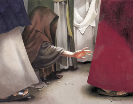 woman reaches out to touch Jesus clothes