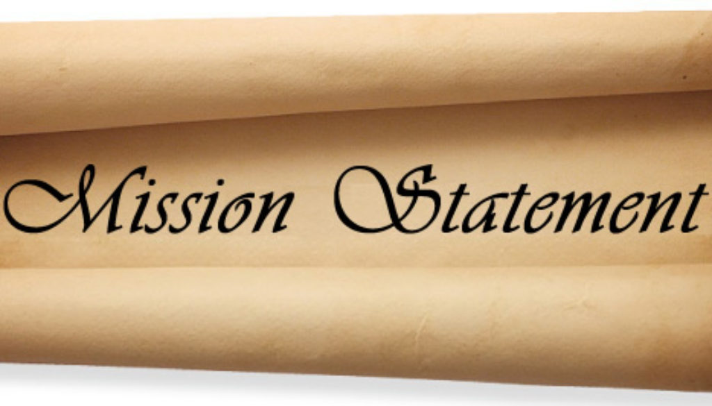 scroll with mission statement written on it